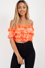 orange off the shoulder crop top