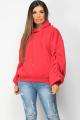 red hoodie with ruched sleeves