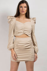 nude skirt and crop top set