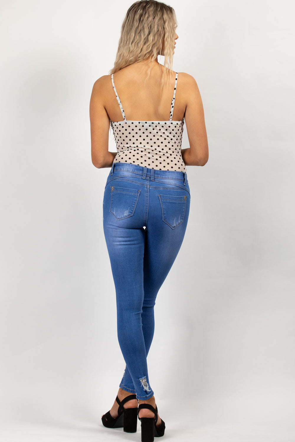 mid wash blue distressed skinny jeans