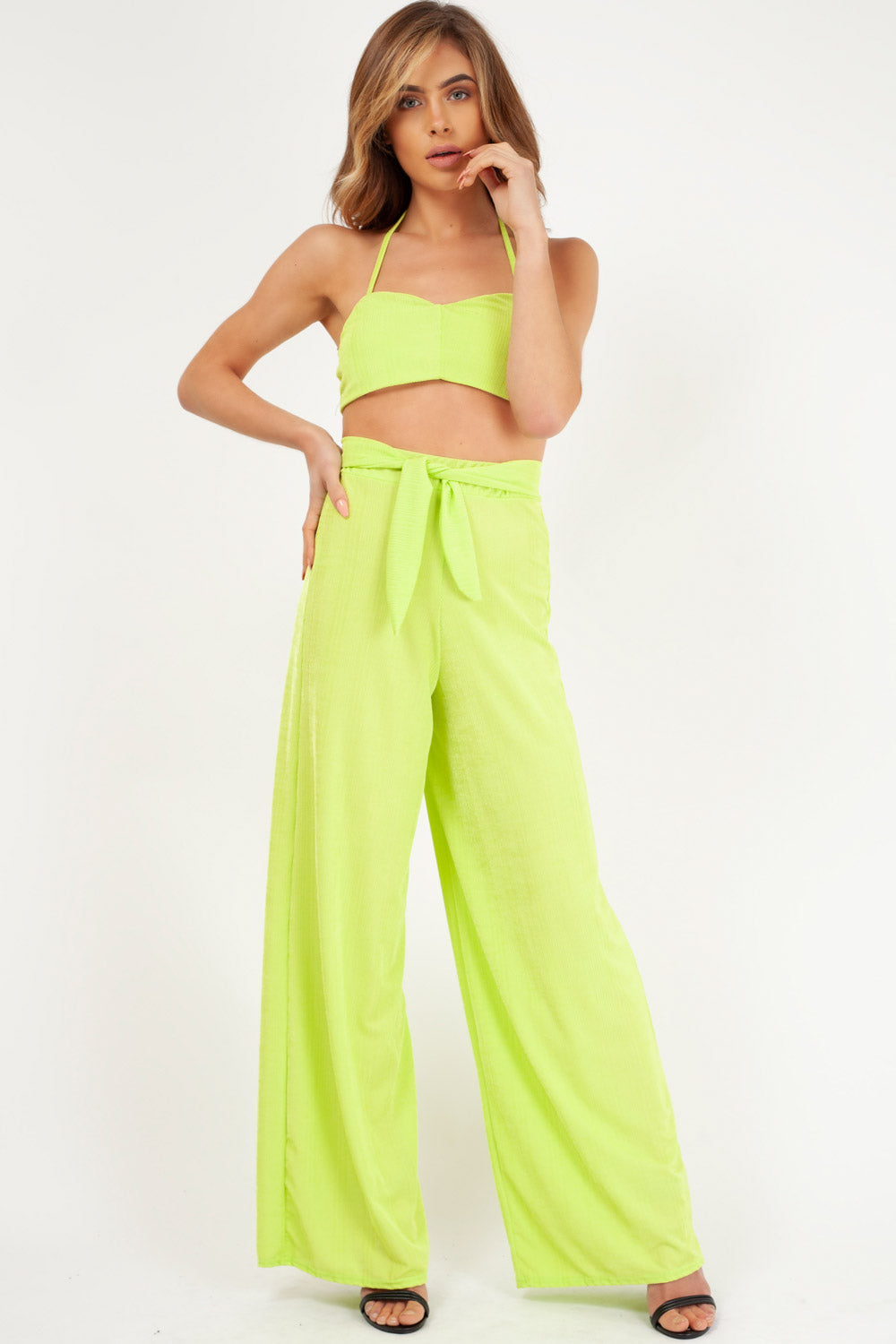 neon yellow crop top and trousers set