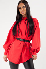 red oversized sweatshirt with utility belt