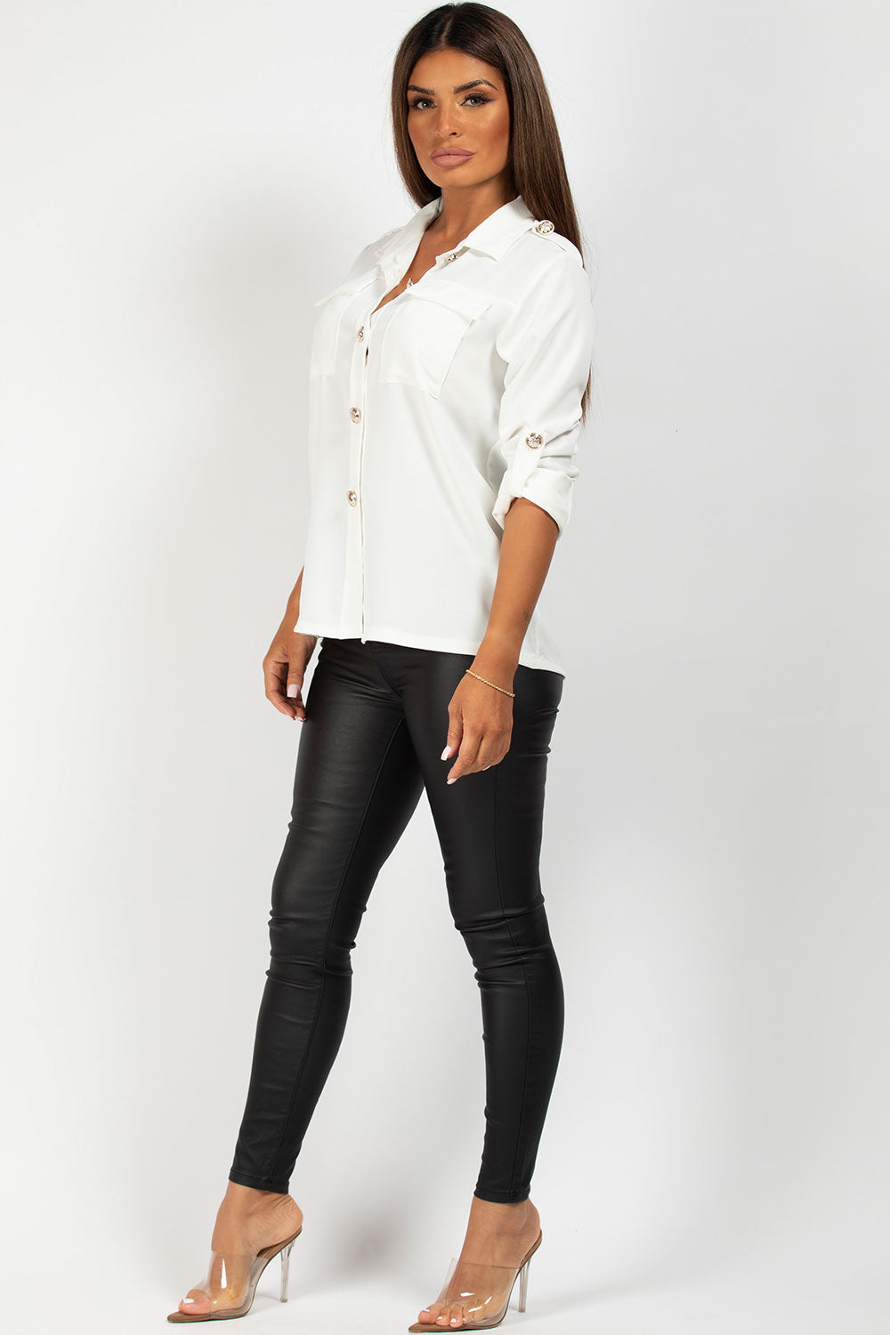 white shirt with gold button detail