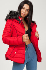 red puffer coat with chunky faux fur hood