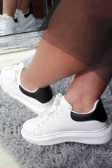 white chunky sole trainers styledup fashion