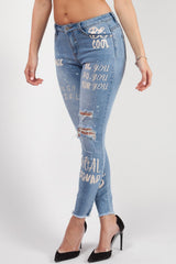 womens ripped graffiti jeans