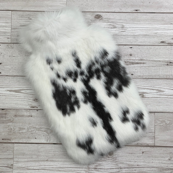 Photo of a large black and white rabbit fur hot water bottle