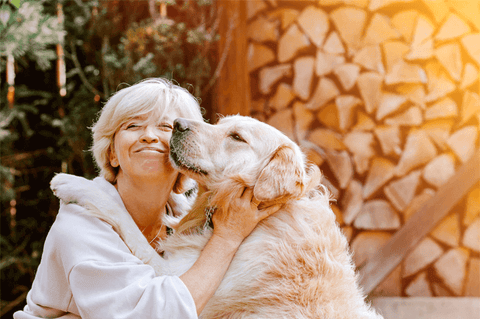 Blond woman hugging his dog
