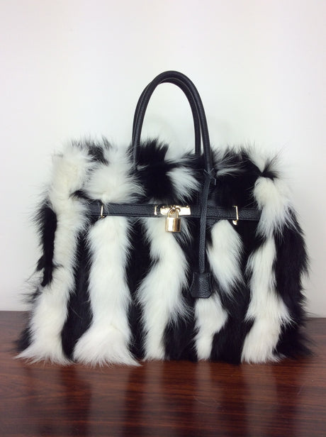 Italian stunning leather bag with black and white fox fur on the front and back
