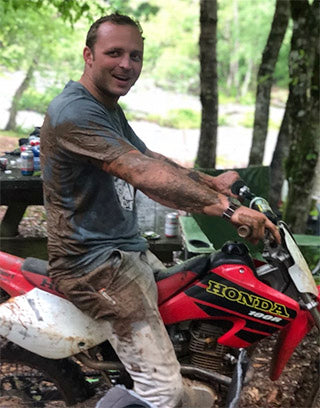 "John Walker on his dirt bike raisin' hell and slingin"" mud in his hometown of Marietta, SC."