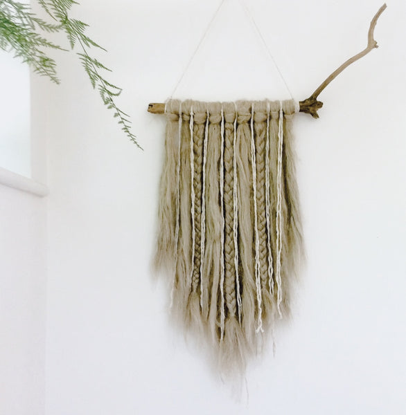 Wall hanging made from merino wool by Nest and Burrow. Love the neutral tones.