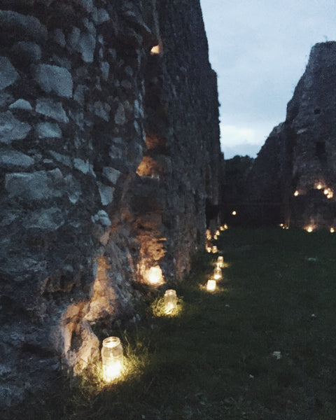 Magical evening with Lewes Priory all lit up by candles.