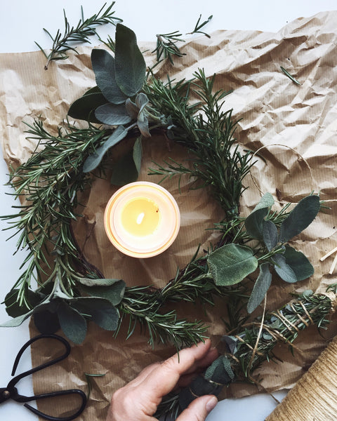 Beautiful natural wreath made from rosemary and sage with Winter Bergamot candle by Essence and Alchemy