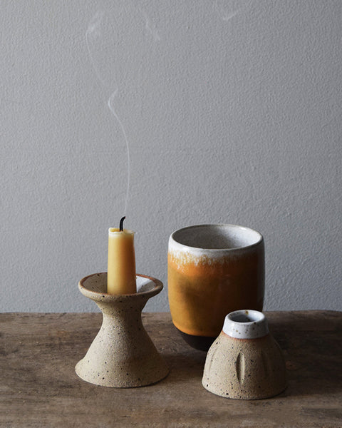 Our hand dipped pure beeswax short dinner candles have a characteristic honey coloured golden tone with a subtle honey scent, filling your room with a beautiful warm glow when lit.