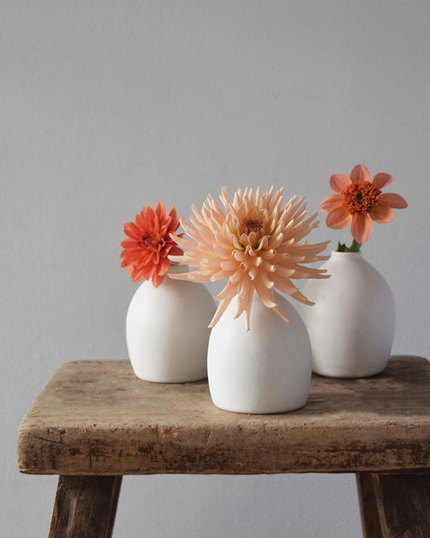 These minimal bud vases have been made using the luxurious clay body of porcelain, wheel thrown by Katie Robbins from KT Robbins Ceramics.