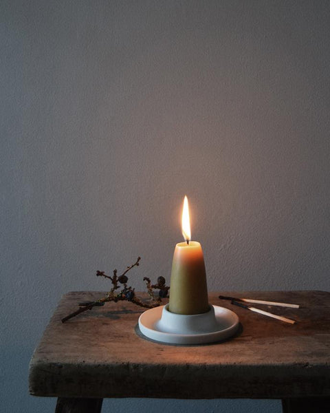 Handmade ceramic candle holder | Hand thrown in a studio in Birmingham by Katie Robbins, each porcelain candle holder is unique. They have been finished with a matt white glaze and look perfect with our pure beeswax candles!