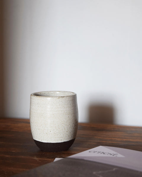 Chalk White ceramic beaker hand thrown in a Brighton studio pottery. The beautiful slightly speckled white glaze reminiscent of our many trips to the iconic Seven Sisters chalk cliffs in East Sussex.