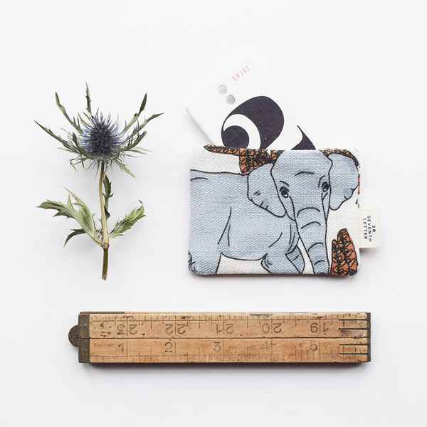 This beautiful card holder with an animal and botanical themed pattern, has been handmade in London from luxurious linen printed in Scotland.