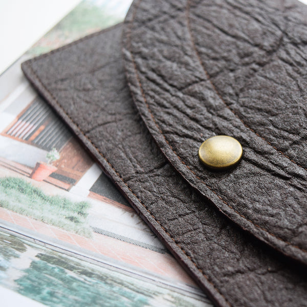 Handcrafted Everything Pouch with gold pebbles print interior, made in Belgium by Grey Whale from leather alternative Piñatex.