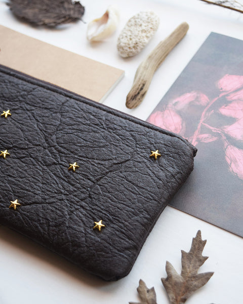 Designed and handcrafted by Grey Whale in a studio in Brussels, this extra spacious and stylish purse is made from leather alternative Piñatex and has gold metal star studs on both sides. It makes a perfect handbag companion as a wallet for your cards, coins, your phone or some make up.