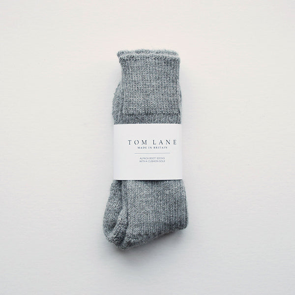 These soft and cosy grey Alpaca socks are perfect for wearing inside your walking boots or wellies! They have a cushion sole for extra comfort and they are breathable to resist moisture. These socks have been made in Nottinghamshire by one of the oldest sock manufacturers in the UK using traditional techniques.