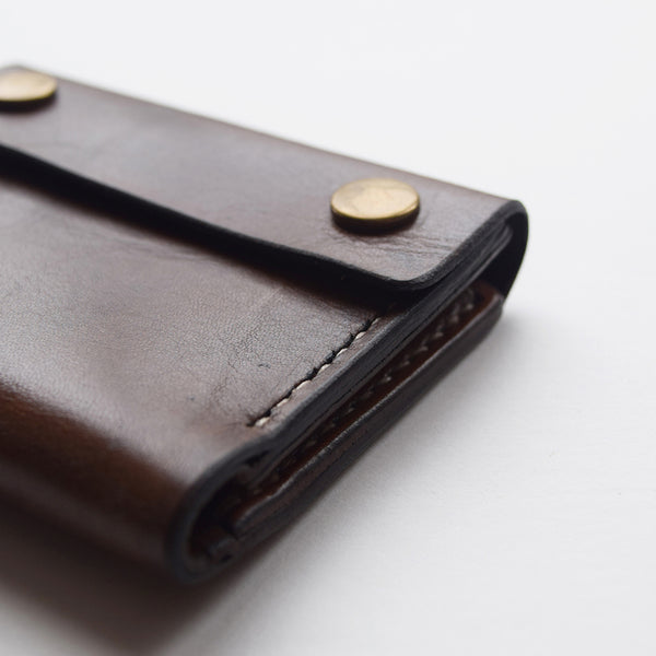 Handcrafted vegetable tanned mens leather wallet made in the UK.