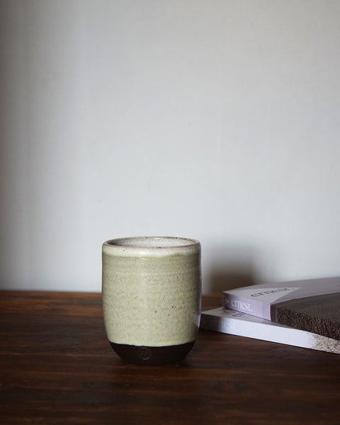 Hand thrown in a Brighton studio pottery, the beautiful slightly speckled light green glaze reminiscent of our ancient woodland adventures, leaves a lovely tactile orange peel texture to the beaker when holding it.