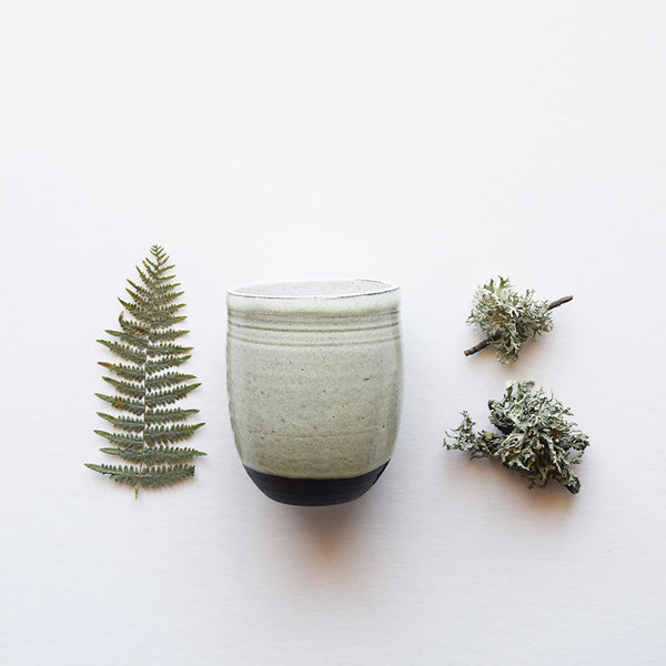 Handmade ceramic coffee cup | Hand thrown in a Brighton studio pottery, the beautiful slightly speckled light green glaze reminiscent of our ancient woodland adventures, leaves a lovely tactile orange peel texture to the beaker when holding it.