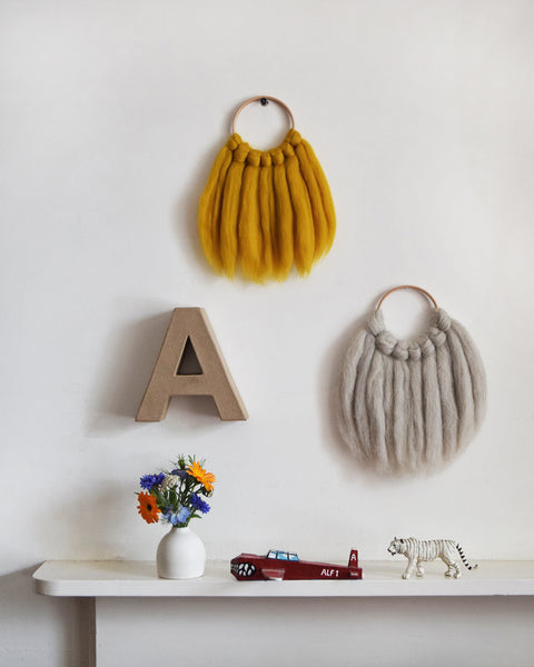 Mini woven wall hanging, designed and handcrafted in the UK from ethically sourced pure merino wool in mustard. It looks gorgeous in kids rooms and nurseries.