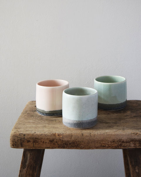 Hand thrown porcelain beaker by KT Robbins Ceramics, glazed with a two-tone colour and matt finish, using shades reminiscent of the misty Welsh landscape and open slate mines.