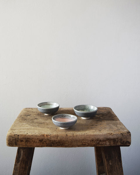 Hand thrown in a studio in Birmingham by Katie Robbins, each mini-bowl has been glazed with a two-tone colour, using shades reminiscent of the Welsh slate mines and green hills found near Cardigan Bay.