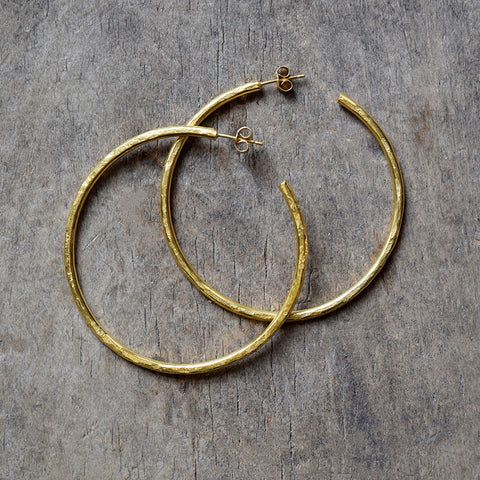 Handmade gold vermeil hoop earrings with a matt hammered surface inspired by textures found in the natural world.