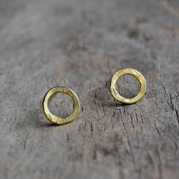Handmade gold vermeil stud earrings with a matt hammered surface inspired by textures found in the natural world.