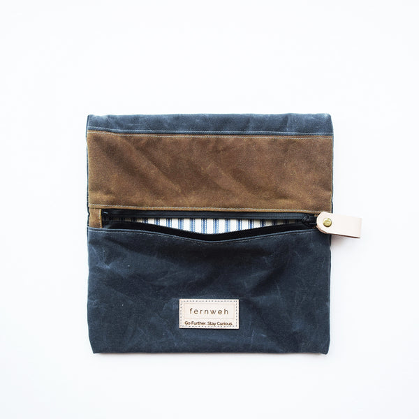 A beautiful and practical waxed cotton outdoor pouch, designed and handcrafted in a seaside studio in Aberdeen. This pouch is perfect for keeping your important items, like maps, travel documents, phone, or other essentials safe when out on your everyday adventures, travels and hiking trips.