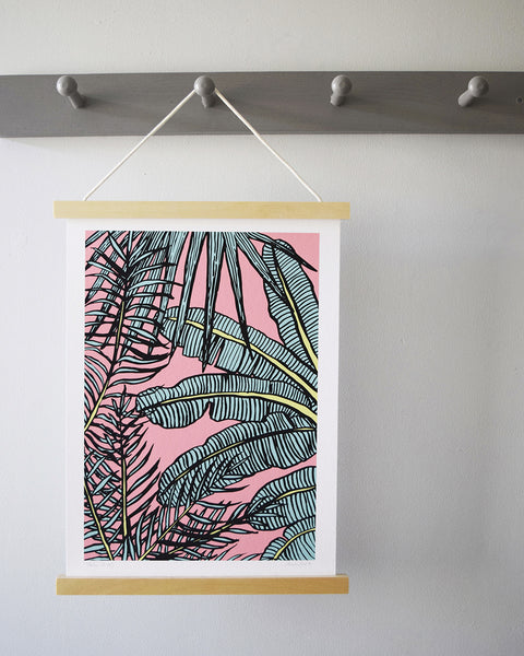 A beautiful botanical art print of a canopy of palm leaves. Drawn in brush and ink, and digitally coloured by Anna Vartiainen, who has her studio in Sussex.
