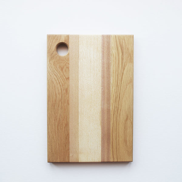 Wooden chopping board handmade in a workshop in Sussex. Beautiful and functional, each board is unique and perfect for your kitchen. It can be used either as a cutting or serving board.