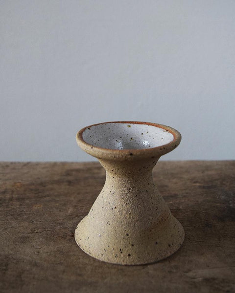 Hand thrown in a studio in East London, each of these beautiful speckled clay candle holders is unique.