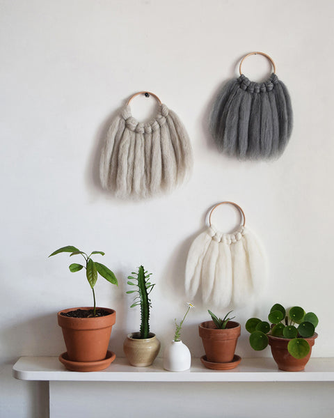 Mini woven wall hanging, designed and handcrafted in the UK from ethically sourced pure merino wool in natural.