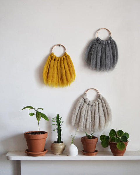 Mini woven wall hanging, designed and handcrafted in the UK from ethically sourced pure merino wool in mustard.