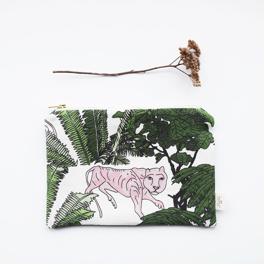 This beautiful zippered pouch with an animal and botanical themed pattern, has been handmade in London from luxurious linen printed in Scotland.