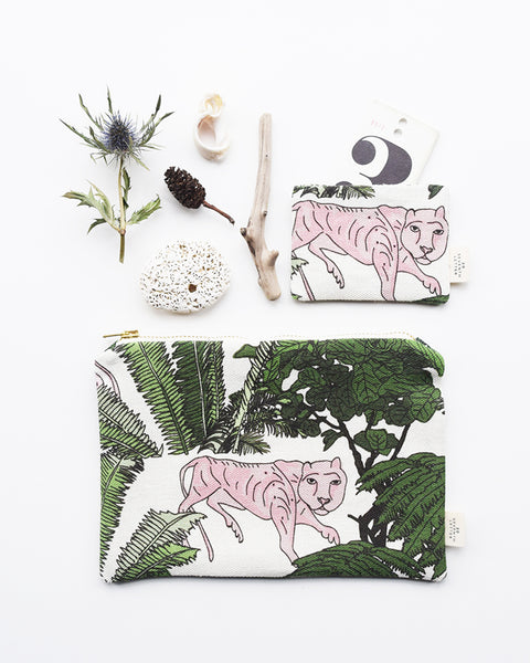 This beautiful zippered pouch and card holder with an animal and botanical themed pattern, have been handmade in London from luxurious linen printed in Scotland.