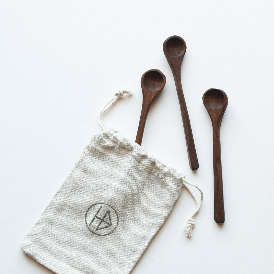 Three little spoons, handcrafted by Hatchet & Bear using reclaimed walnut wood, scoop heaven for your salt, spices and condiments on your table. Each one is unique and make perfect utensils for the rustic homemaker.