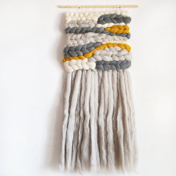 A beautiful woven wall hanging, designed and handcrafted in the UK from ethically sourced pure merino wool.