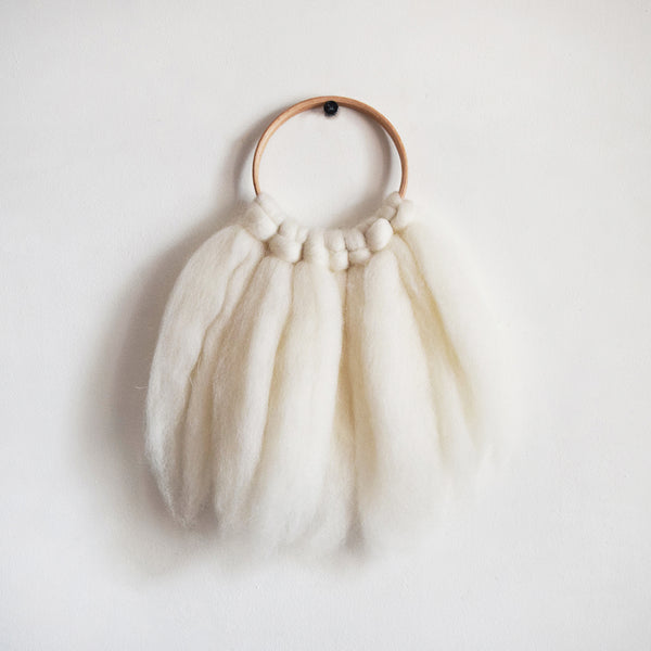 Mini woven wall hanging, designed and handcrafted in the UK from ethically sourced pure merino wool in white.