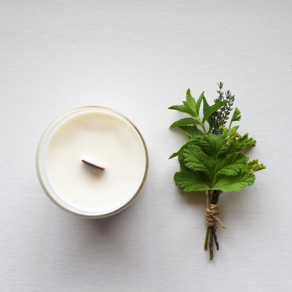 Wild Garden, a botanical aromatherapy candle by Essence and Alchemy, 100% natural, sustainable and eco-friendly. Candles are hand-poured in a British made re-usable mouth-blown glass beaker with a wooden wick.