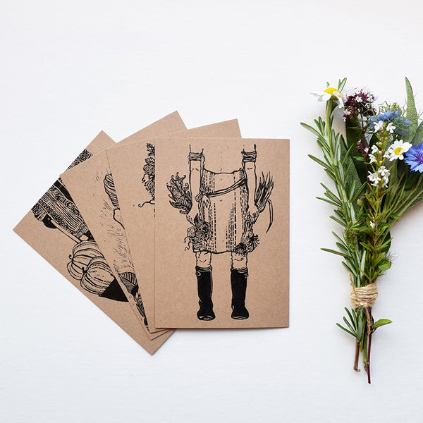 A beautiful set of postcards featuring mini prints hand carved from original linocut and woodcut prints by Rosanna Morris. The postcard designs include 'Boots', 'Flower Harvest', 'Mary' and 'Wheelbarrow'.