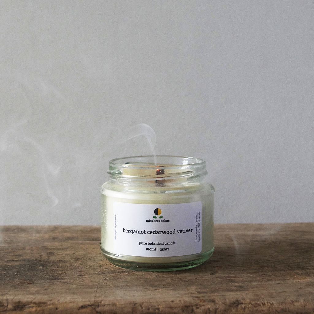 This 100% natural Pure Botanical Candle by miss bees balms is made using organic essential oils of refreshing bergamot, calming cedarwood, and deeply relaxing vetiver.