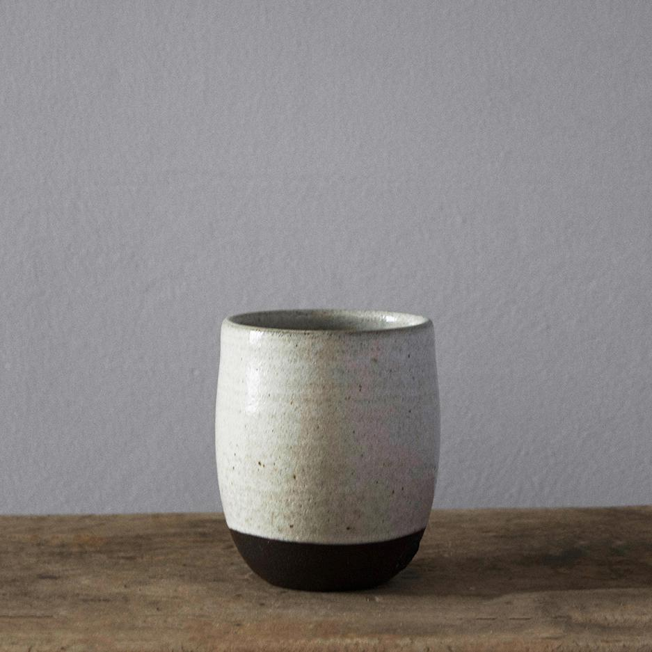 Handmade ceramic coffee cup | Chalk White ceramic beaker hand thrown in a Brighton studio pottery. The beautiful slightly speckled white glaze reminiscent of our many trips to the iconic Seven Sisters chalk cliffs in East Sussex.