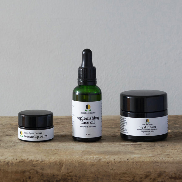 Organic Replenishing Face Oil, dry skin balm and rescue lip balm by miss bees balms, handmade individually in small batches using only the finest cold pressed oils and floral, herbaceous and spicy aromatics.
