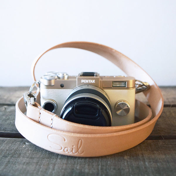 Handcrafted leather camera strap in a classic retro style design. Made in the UK from vegetable tanned leather.